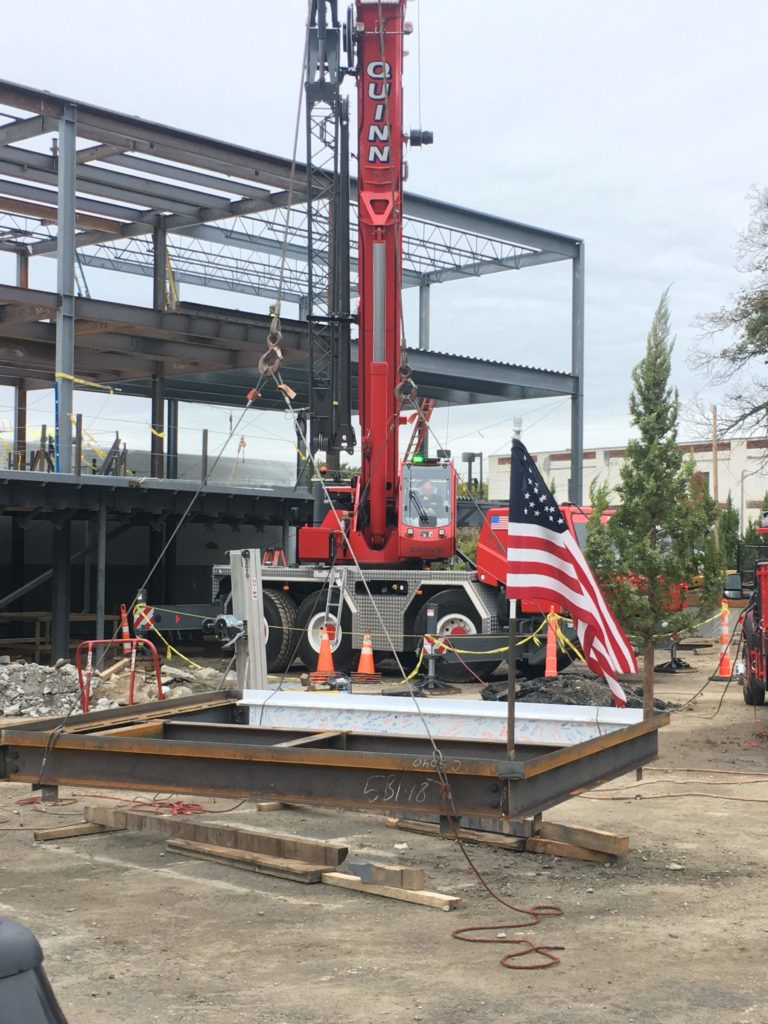 About to raise the last steel beam, which was signed by donors, board members, and staff, on the frame of the new building!